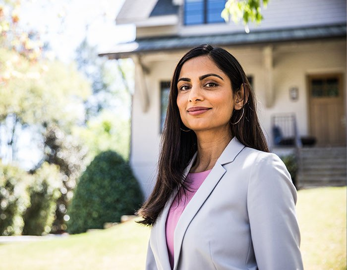 Membership - real estate professional in front of a house