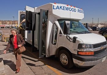 A shuttlebus in Lakewood, CO dropping off a passenger