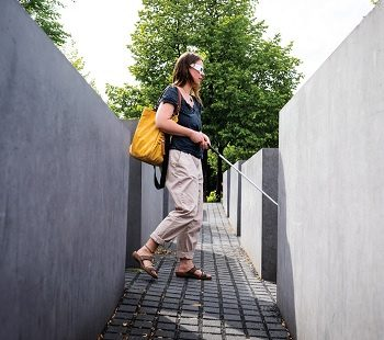 Visually impaired woman walking inside the Holocaust Memorial, Berlin