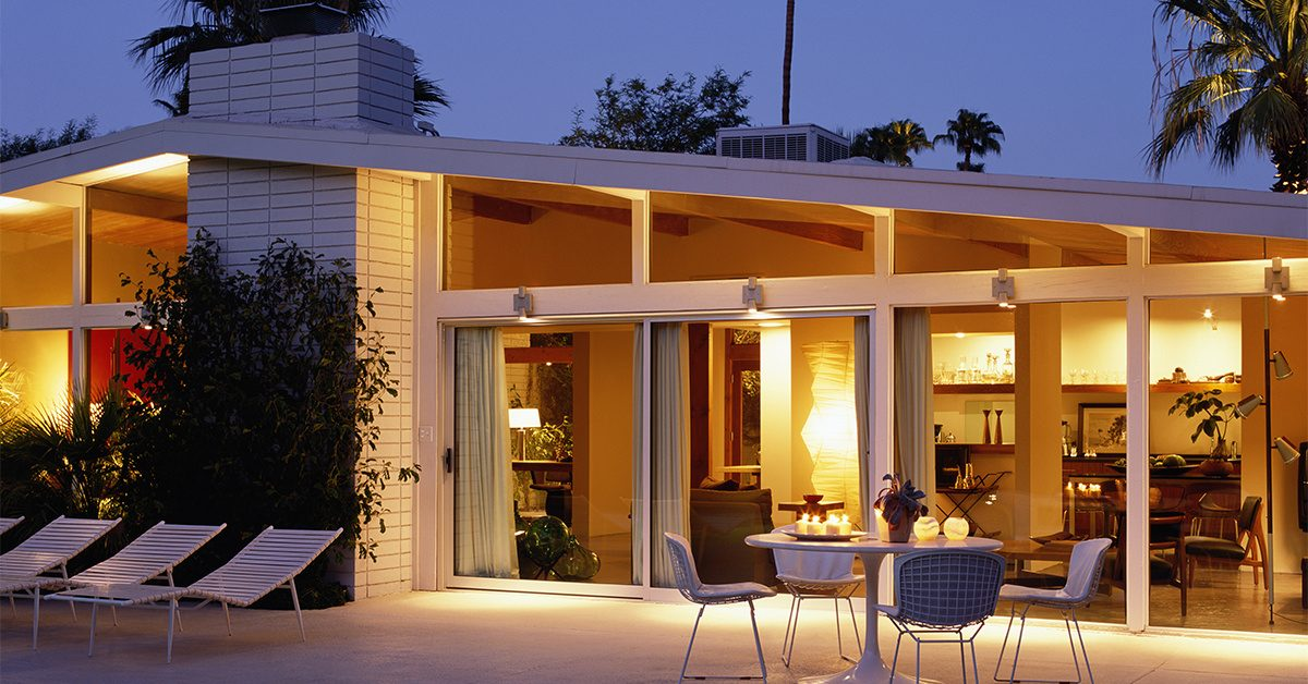 Modern house exterior at dusk, with patio