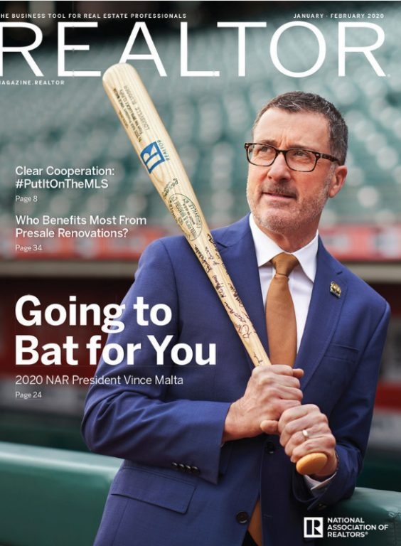 Image of Vince Malta holding a baseball bat with the REALTOR® R logo in a baseball stadium.