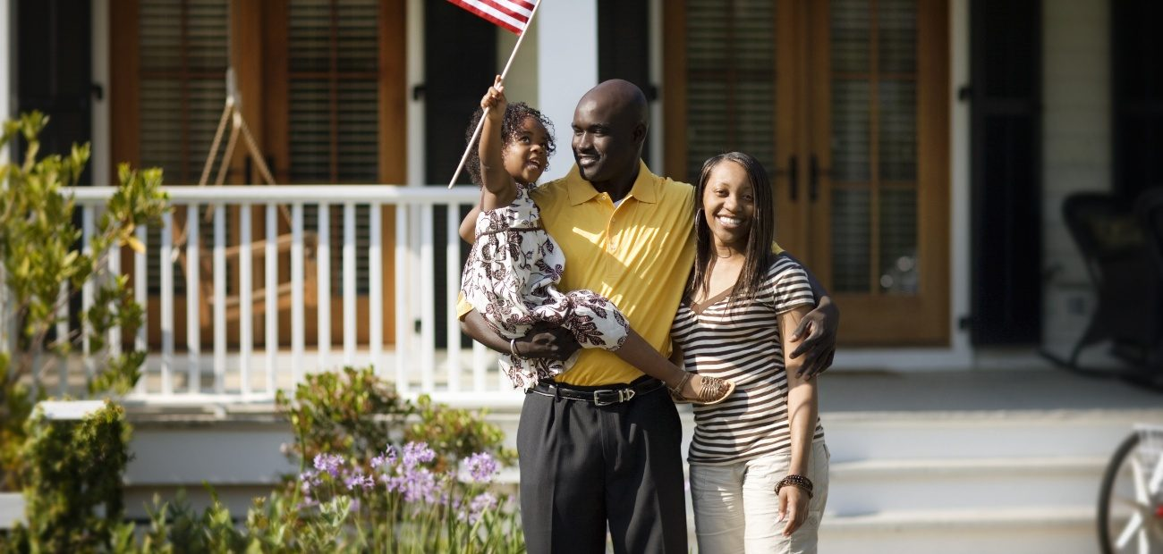 A Family waving an American flag