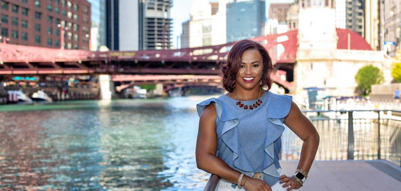Michelle Mills Clement, RCE, CAE posing by Chicago River