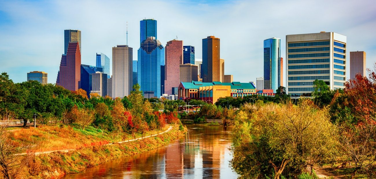 The skyline of downtown Houston, Texas shot from a bridge over the Buffalo Bayou within Eleanor Tinsley Park.