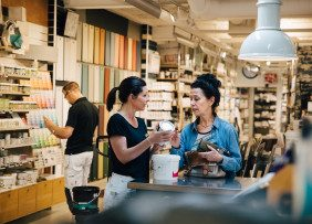 Saleswoman and customer in a paint store
