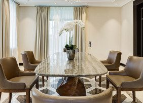 Staged dining room with orchid on table