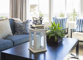 Living room staged with blue and white furnishings