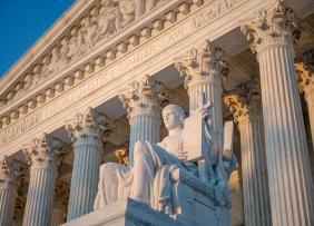 US Supreme Court statue and pillars